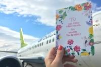 airBaltic lidojuma laikā var nosūtīt īpašas pastkartes